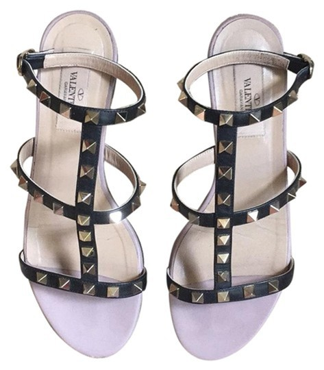 Preload https://item2.tradesy.com/images/valentino-black-rockstud-collection-sandals-size-eu-37-approx-us-7-regular-m-b-25681426-0-0.jpg?width=440&height=440