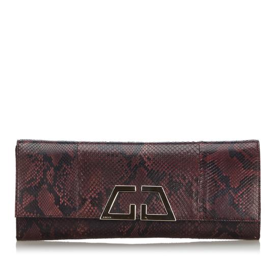 Preload https://img-static.tradesy.com/item/25683004/gucci-python-night-italy-dust-small-red-snakeskin-leather-clutch-0-0-540-540.jpg