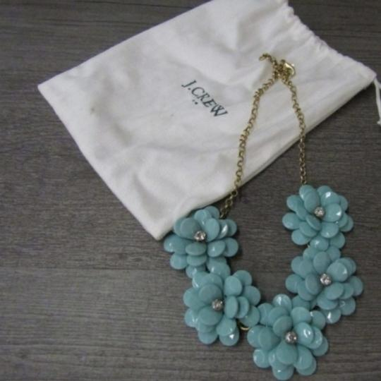 Preload https://item2.tradesy.com/images/jcrew-turquoise-and-rhinestone-flower-necklace-25684561-0-1.jpg?width=440&height=440