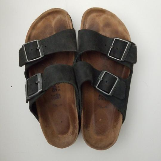 Preload https://item4.tradesy.com/images/birkenstock-blackoiled-leather-arizona-oiled-sandals-size-us-7-regular-m-b-25684818-0-0.jpg?width=440&height=440