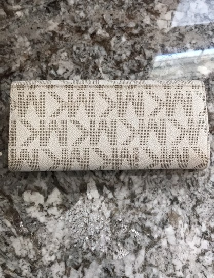 MICHAEL Michael Kors Off white with tan lettering. Clutch Image 1
