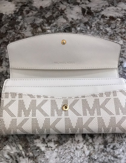 MICHAEL Michael Kors Off white with tan lettering. Clutch Image 4
