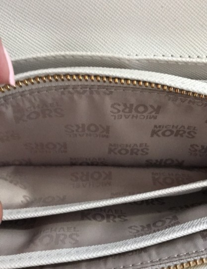 MICHAEL Michael Kors Off white with tan lettering. Clutch Image 8