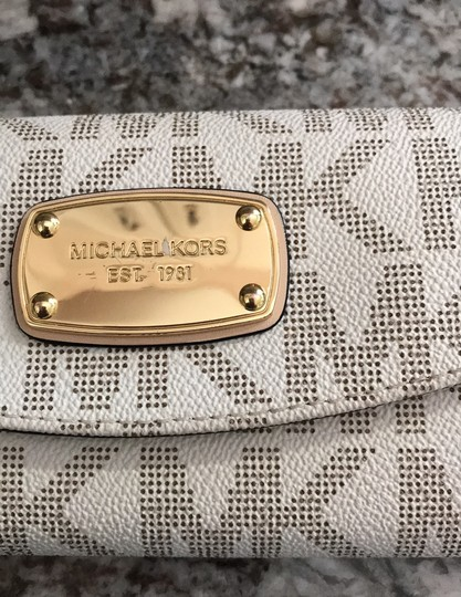 MICHAEL Michael Kors Off white with tan lettering. Clutch Image 9