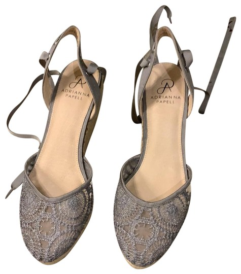 Preload https://img-static.tradesy.com/item/25708577/adrianna-papell-silver-lace-wedges-size-us-75-regular-m-b-0-1-540-540.jpg