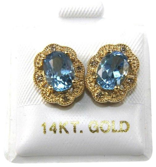 Preload https://img-static.tradesy.com/item/25709394/oval-blue-topaz-and-diamond-halo-stud-14k-yellow-gold-184ct-earrings-0-1-540-540.jpg