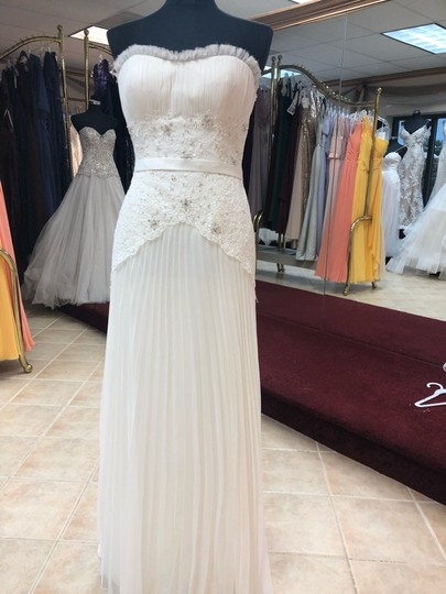 Preload https://img-static.tradesy.com/item/25714916/anjolique-ivory-chiffon-and-lace-light-airy-gown-with-beaded-top-destination-wedding-dress-size-4-s-0-0-540-540.jpg