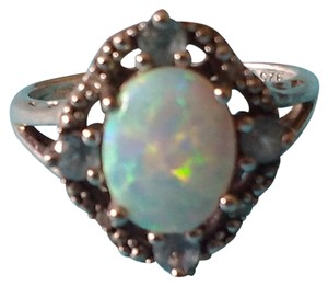 Jared Jared's White Opal Ring with Topaz and Diamonds