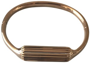 Tory Burch Rose Gold Fit Bit Bracelet and Fit Bit