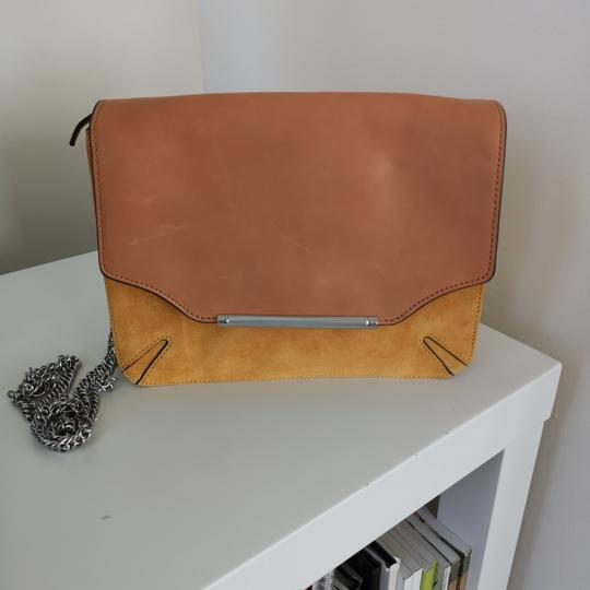 Preload https://img-static.tradesy.com/item/25723693/rag-and-bone-clutch-marigold-moto-with-chain-suede-leather-cross-body-bag-0-0-540-540.jpg