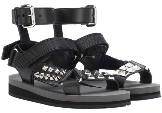 Preload https://img-static.tradesy.com/item/25728517/prada-black-studded-strap-flat-leather-sandals-size-us-8-regular-m-b-0-1-540-540.jpg