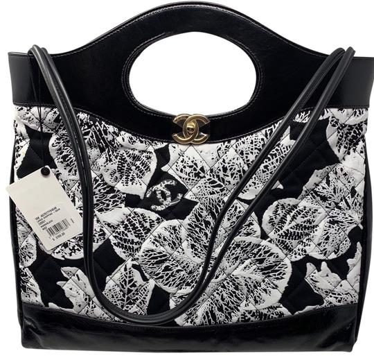 Preload https://img-static.tradesy.com/item/25729985/chanel-shopping-bag-calfskin-printed-31-medium-black-and-white-tote-0-1-540-540.jpg