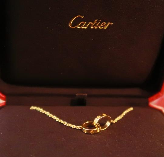 Cartier Cartier Love necklace 18K Yellow Gold w/ Mini Double Ring Pendant Image 1