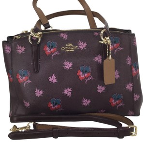 Coach Satchel in Oxblood with wild flower multi print