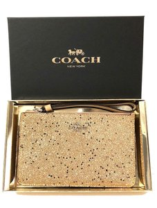 Coach Wristlet in Gold
