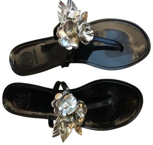 Tory Burch black with gold flowers Sandals