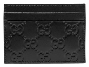 Gucci GG logo embossed leather card holder