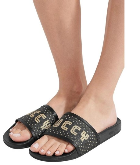 Preload https://img-static.tradesy.com/item/25761070/gucci-black-and-gold-printed-pursuit-slide-sandals-flats-size-us-9-regular-m-b-0-0-540-540.jpg