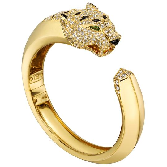 Preload https://img-static.tradesy.com/item/25765198/cartier-yellow-gold-diamond-black-onyx-panthere-cuff-size-17-bracelet-0-0-540-540.jpg