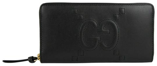 Preload https://img-static.tradesy.com/item/25766305/gucci-black-apollo-leather-embossed-gg-zip-around-453393-wallet-0-1-540-540.jpg