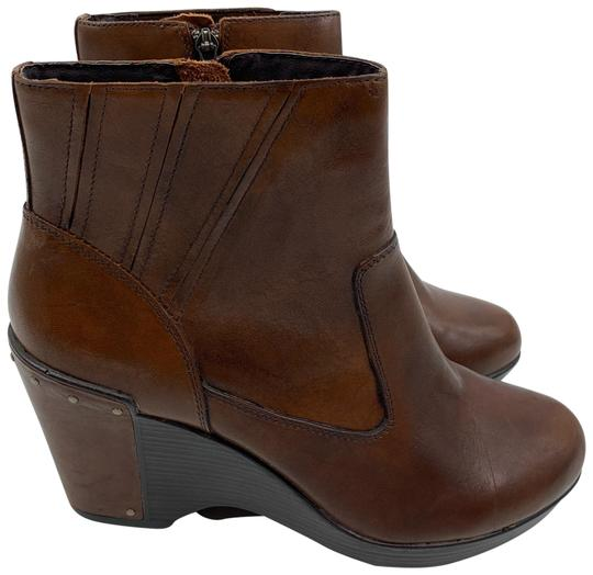 Preload https://img-static.tradesy.com/item/25766696/dansko-brown-faith-wedge-ankle-bootsbooties-size-eu-41-approx-us-11-regular-m-b-0-1-540-540.jpg