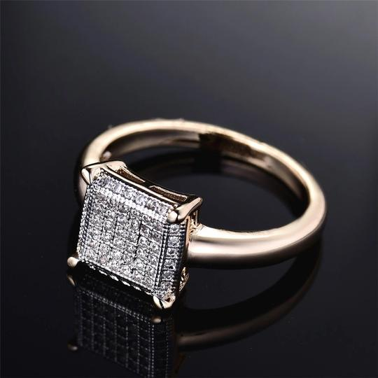 100% Brand New Fashion Women Ring *Metal Color:14k Gold Plated *Material:Copper+AAA Cubic Zirconia *Size Available:7 *Main Stone Size:1mm *Stone Color:White *Weight:2.7grams(approx) *Come with a pretty box 100% Brand New Fashion Women Ring *Metal Color:14k Gold Plated *Material:Copper+AAA Cubic Zirconia *Size Available:7 *Main Stone Size:1mm *Stone Color:White *Weight:2.7grams(approx) *Come with a pretty box Image 2