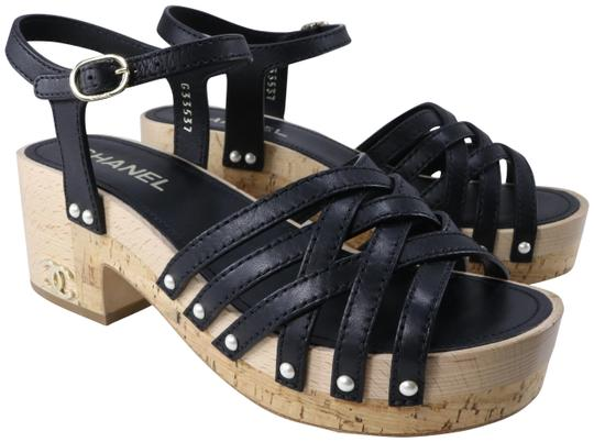 Preload https://img-static.tradesy.com/item/25768535/chanel-black-pearl-studded-strappy-wood-cork-platform-b930-sandals-size-eu-36-approx-us-6-regular-m-0-1-540-540.jpg
