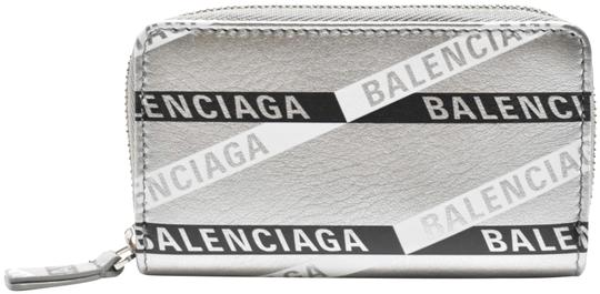 Preload https://img-static.tradesy.com/item/25768736/balenciaga-silver-everyday-leather-logo-print-zip-around-card-case-coin-pouch-wallet-0-2-540-540.jpg