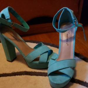 Breckelle's Turquoise, teal green Platforms
