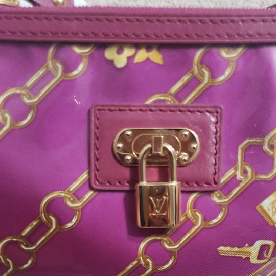 Louis Vuitton Monogram Locks And Charms Pink Limited Edition Purple Clutch Image 11
