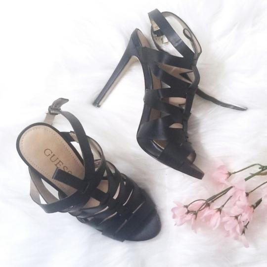 Preload https://item2.tradesy.com/images/guess-black-strappy-heels-pumps-size-us-7-regular-m-b-25775831-0-1.jpg?width=440&height=440