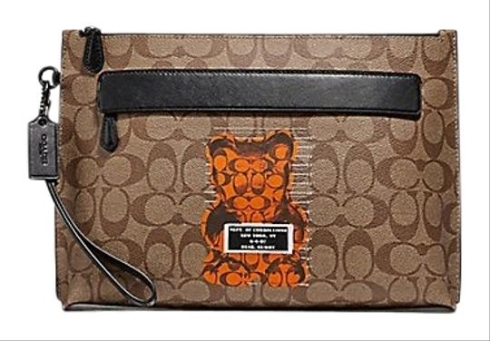 Preload https://img-static.tradesy.com/item/25779177/coach-carryall-w-new-arrival-pouch-in-signature-w-vandal-gummy-multicolor-coated-canvas-wristlet-0-2-540-540.jpg