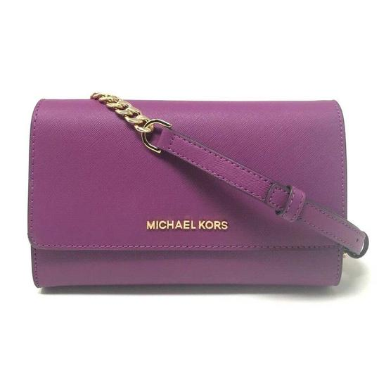Preload https://img-static.tradesy.com/item/25781920/michael-kors-clutch-jet-set-travel-3-in-1-wristlet-pomegranate-canvas-leather-cross-body-bag-0-0-540-540.jpg