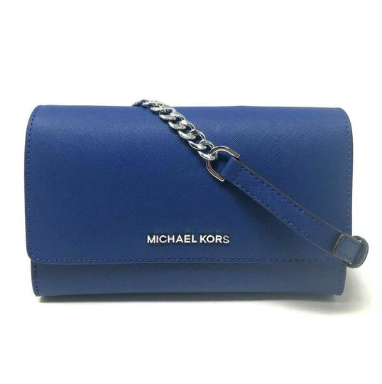 Preload https://img-static.tradesy.com/item/25781963/michael-kors-clutch-jet-set-travel-3-in-1-wristlet-sapphire-canvas-leather-cross-body-bag-0-0-540-540.jpg