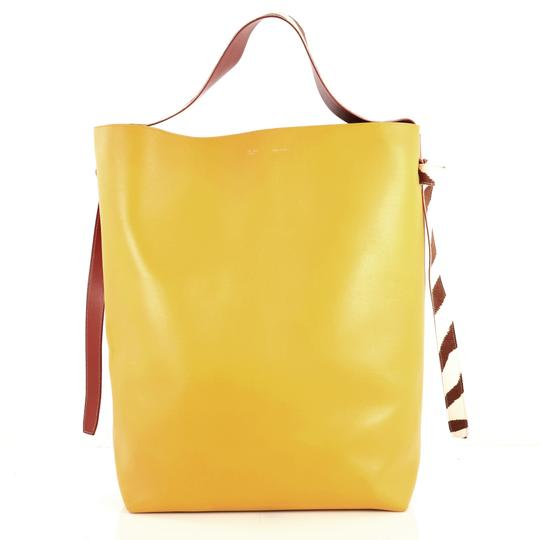 Preload https://img-static.tradesy.com/item/25782422/celine-twisted-cabas-tote-with-felt-oversized-red-and-yellow-leather-hobo-bag-0-0-540-540.jpg