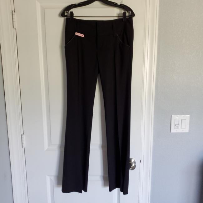 Preload https://item5.tradesy.com/images/alice-olivia-black-with-black-leather-detail-on-pockets-dress-pant-only-got-to-wear-1-time-pants-siz-25782749-0-0.jpg?width=400&height=650