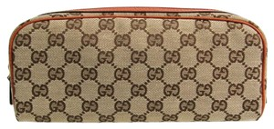 Gucci Beige / Dark orange Clutch