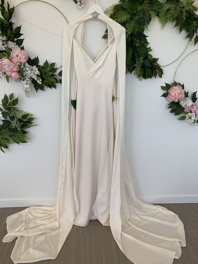 Preload https://img-static.tradesy.com/item/25794885/pronovias-ivory-cream-crepe-moonlight-sexy-wedding-dress-size-6-s-0-0-540-540.jpg