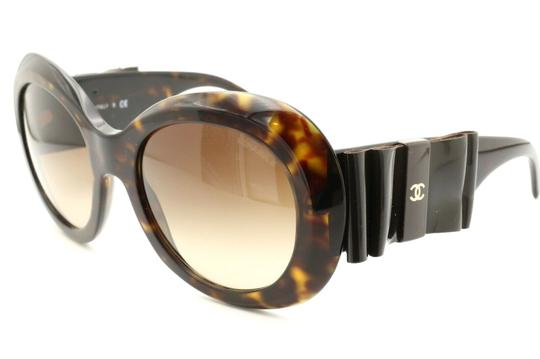 Preload https://img-static.tradesy.com/item/25809169/chanel-brown-ch5282-q-c714s5-havana-frame-large-leather-bow-56mm-italy-sunglasses-0-0-540-540.jpg