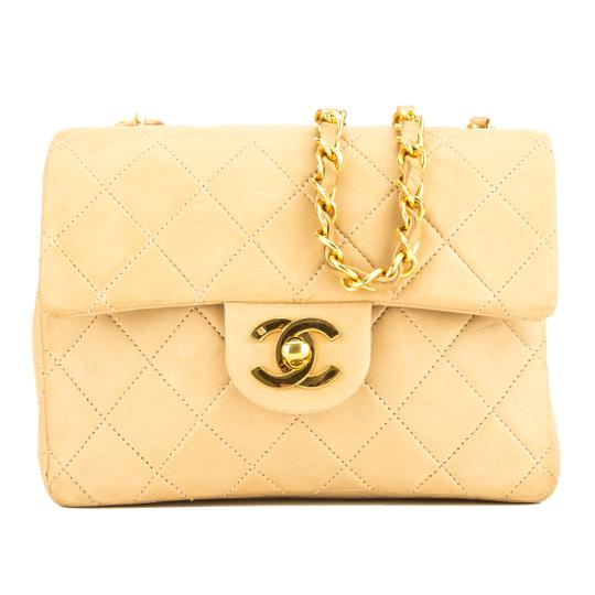 Preload https://img-static.tradesy.com/item/25810942/chanel-classic-flap-quilted-square-mini-7000241-beige-lambskin-shoulder-bag-0-0-540-540.jpg