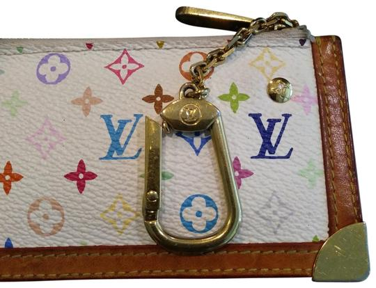 Preload https://img-static.tradesy.com/item/25814448/louis-vuitton-multicolor-white-gold-coin-pouch-wallet-0-2-540-540.jpg