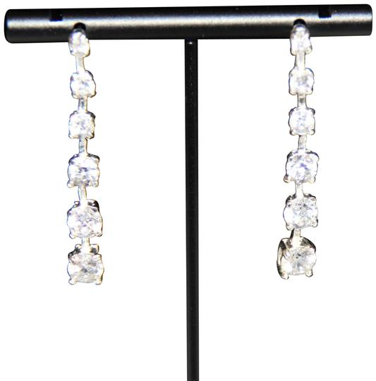 Preload https://img-static.tradesy.com/item/25819413/silver-elegant-polished-linear-sparkling-cubic-zirconia-earrings-0-1-540-540.jpg