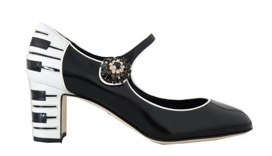 Preload https://img-static.tradesy.com/item/25822411/dolce-and-gabbana-blackwhite-leather-mary-janes-crystals-pumps-size-eu-375-approx-us-75-regular-m-b-0-0-540-540.jpg