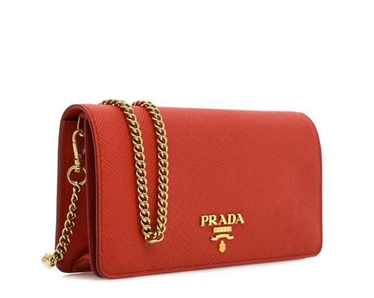 Preload https://img-static.tradesy.com/item/25822479/prada-chain-wallet-red-leather-cross-body-bag-0-0-540-540.jpg