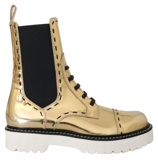 Preload https://img-static.tradesy.com/item/25823436/dolce-and-gabbana-gold-leather-mid-calf-bootsbooties-size-eu-365-approx-us-65-regular-m-b-0-1-540-540.jpg