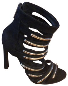 SCHUTZ Black and gold. Formal