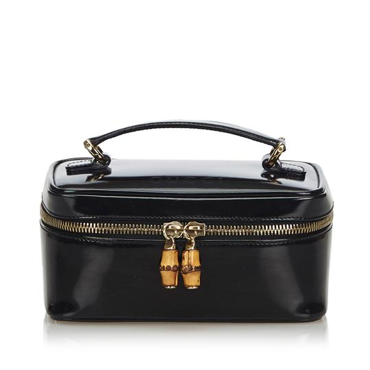 Preload https://img-static.tradesy.com/item/25831117/gucci-black-box-w-patent-leather-bamboo-vanity-italy-small-cosmetic-bag-0-0-540-540.jpg