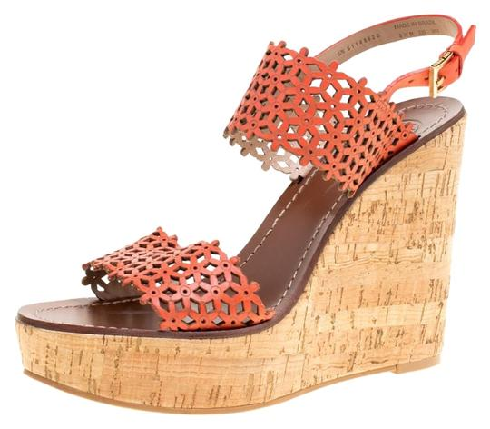 Preload https://img-static.tradesy.com/item/25832198/tory-burch-red-coral-perforated-leather-daisy-cork-wedge-sandals-size-eu-39-approx-us-9-regular-m-b-0-1-540-540.jpg