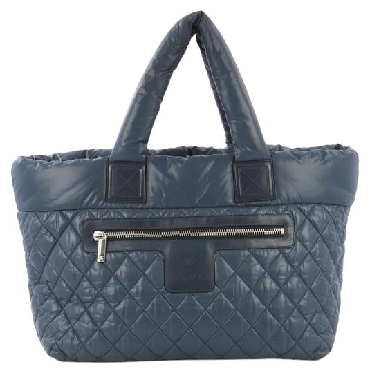Preload https://img-static.tradesy.com/item/25834104/chanel-cocoon-coco-zipped-quilted-large-blue-nylon-tote-0-1-540-540.jpg
