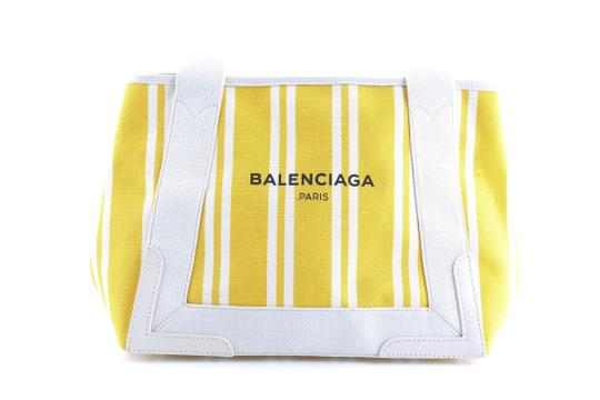 Preload https://img-static.tradesy.com/item/25834162/balenciaga-tote-cabas-yellow-canvas-shoulder-bag-0-0-540-540.jpg